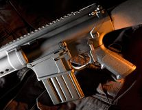 Side lit assault rifle with orange Stock Photography