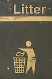 Side of a litter bin. The side of a litter bin showing the throw away symbol stock photos