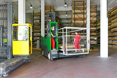Side loader forklifts. Multi directional forklifts for the material handling industry Stock Photography