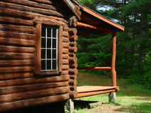 Side of Log Cabin. The side and porch on a log cabin Royalty Free Stock Image