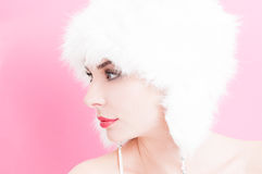 Side look of a young model wearing fur hat Stock Photos