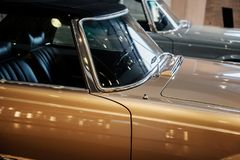 Free Side, Lose Up View Of Beige Retro Cabriolet Car With Black Roof, Steering Wheel, Chrome Window Trim And Windshield Stock Photo - 165326520