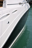 Side of luxury yacht. Side view of a luxury yacht, with streamline shape and beautiful color, shown as marine activity, travel or in maintenance Stock Photography