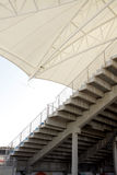 Side of Main grandstand showing the steps and roof Stock Photo