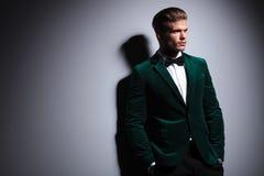 Side of a man in green velvet elegant suit Royalty Free Stock Image