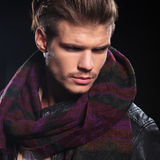 Side of a man in leather jacket and big scarf Royalty Free Stock Images