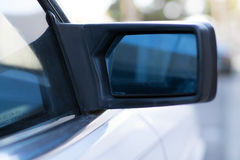 Side mirror on car. Rear view side mirror on a car Royalty Free Stock Photo