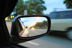 Side mirror. Of car.Blurred road and car, speed motion background Royalty Free Stock Photography