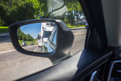 Side mirror of a car. At drive Stock Photos