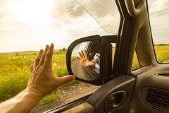 Side mirror on the car on the road.  Stock Photo
