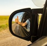 Side mirror on the car on the road.  Royalty Free Stock Photos