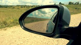 Side mirror of the car. In the movement stock video footage