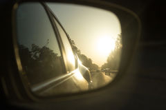 Side mirror in a car. On the sunset. trave by car concept Stock Photography