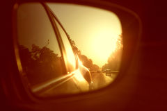 Side mirror in a car. On the sunset. trave by car concept Stock Image