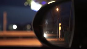 Side mirror rear view from standing car at night. Stock Photos
