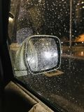 Side Mirror Reflection On A Rainy Night royalty free stock photo