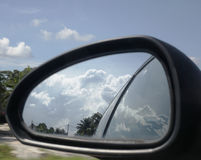 Side mirror reflective. Blue clouds can be seen through a side Royalty Free Stock Image