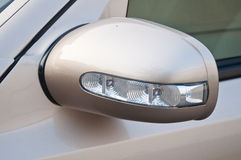Side mirror with turn signal of a car Royalty Free Stock Images