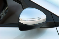 Side mirror with turn signal of a car Royalty Free Stock Image