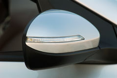 Side mirror with turn signal of a car Stock Image