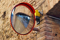 Side mirror on the wall Royalty Free Stock Images