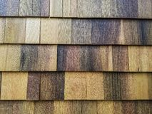 Texture: Cedar siding shingles on a house-2. The side of a modern American bungalow style house, newly renovated. These are cedar shingles, giving a wonderful Royalty Free Stock Image