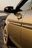 Side of a modern car in sunset light Royalty Free Stock Images