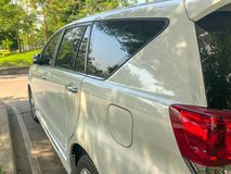 Side of the modern car in thailand. At the park Royalty Free Stock Photo
