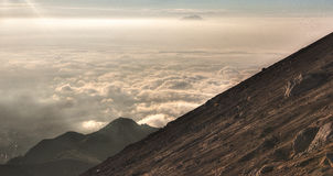 The Side of Mount Merapi in the Clouds Royalty Free Stock Photography