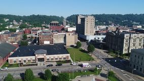 Side Moving Aerial Morning Establishing Shot of Steubenville Ohio. A slow side moving aerial establishing shot (DX) of the small rust belt Ohio town of stock footage