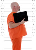 Side mug shot with blank card. A side mug shot of a prisoner with blank information card Royalty Free Stock Photos