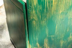 Side of an old cabinet, which is restored for further use and receives a first coat of green paint stock photography