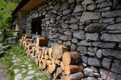 Side of old cottage with wood pile Stock Image