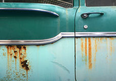 Side of old rusty car. Rusty bodywork on side of old rusty car or automobile Stock Photo