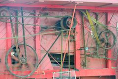 Side of Old Threshing Machine with belts Royalty Free Stock Photography