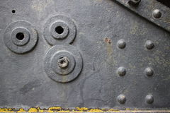 Side of old vintage canon with rivets and holes. Side of old fortress canon in Northern California, showing large rivets, orange lichens, and various holes and Stock Photo