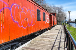 Side of a orange Caboose train Royalty Free Stock Image