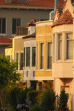 Side of Pastel Houses. The profile of a row of pastel-colored houses with clay-tiled roofs Royalty Free Stock Photos