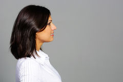 Side photo of a brunette looking at copyspace Royalty Free Stock Images