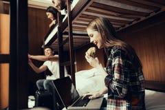 Side photo of Girl eating hamburger in Hostel royalty free stock photo