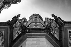 Side pillar of the Gothic Vysehrad cathedral in Prague with beautiful stone statues in black and white Royalty Free Stock Images