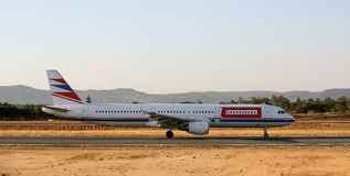 Side plane. Wide view of the side of a commercial plane landing on the airport Stock Photography
