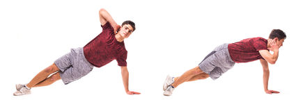 Side Plank Crunch. Young man doing sport exercise. royalty free stock photography