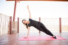Side plank yoga workout pose stock photos