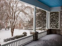 Side porch getting covered with snow stock photography