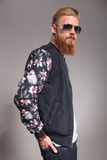 Side portrait of a bearded young man Stock Photos