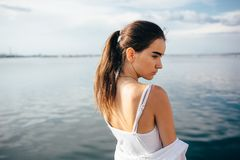 Side portrait of beautiful brunette young woman royalty free stock image