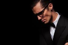 Side portrait of classy elegant man in black suit Stock Photo