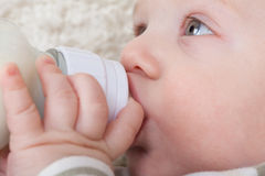 Close-up of a baby with a bottle. Stock Image