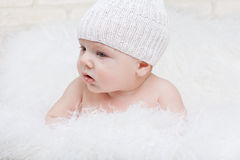Side portrait of a concentrated baby Stock Images